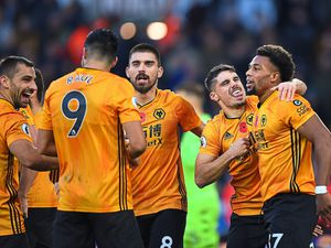 Pedro Neto of Wolverhampton Wanderers and Adama Traore of Wolverhampton Wanderers celebratee after Raul Jimenez of Wolverhampton Wanderers after scored a goal to make it 2-0