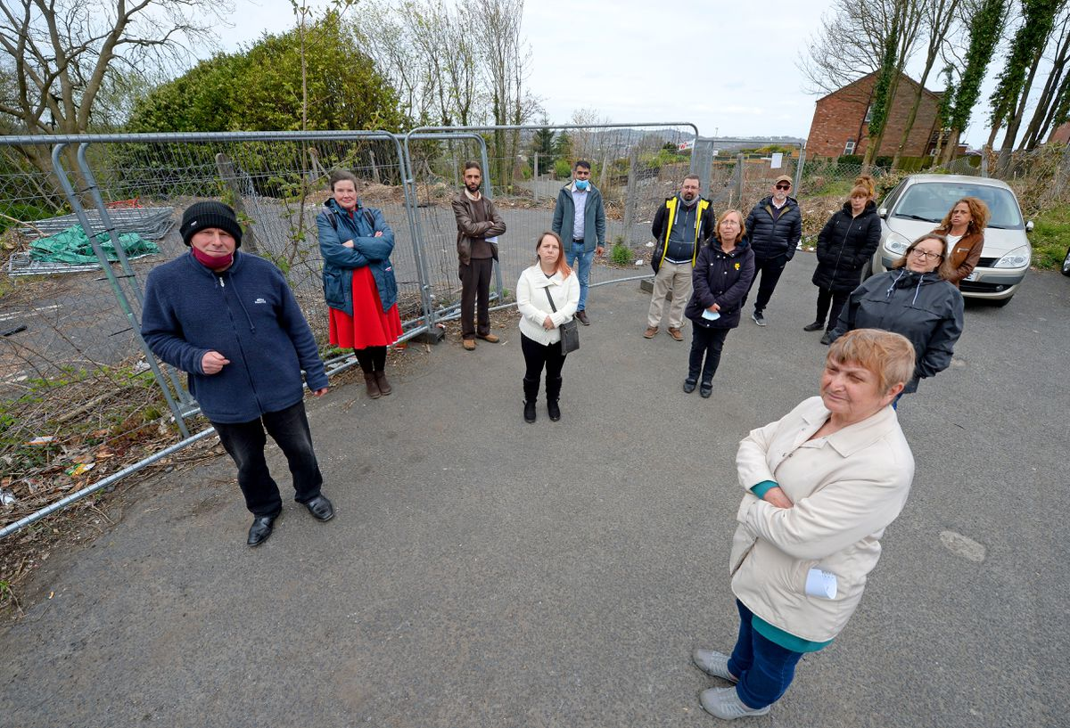 Pictured are residents Alan Morris, front left, and Iris Downey, front right, with fellow residents at the site