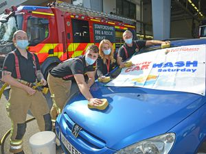 Firefighters Abbi Walker, Sam Knight, Laura Aldred and watch manager Rus Brown have sponges at the ready