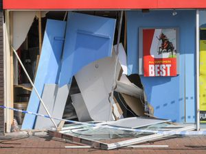 The aftermath of the crash where a car ended up inside Ladbrokes in Aldridge. Photo: SnapperSK