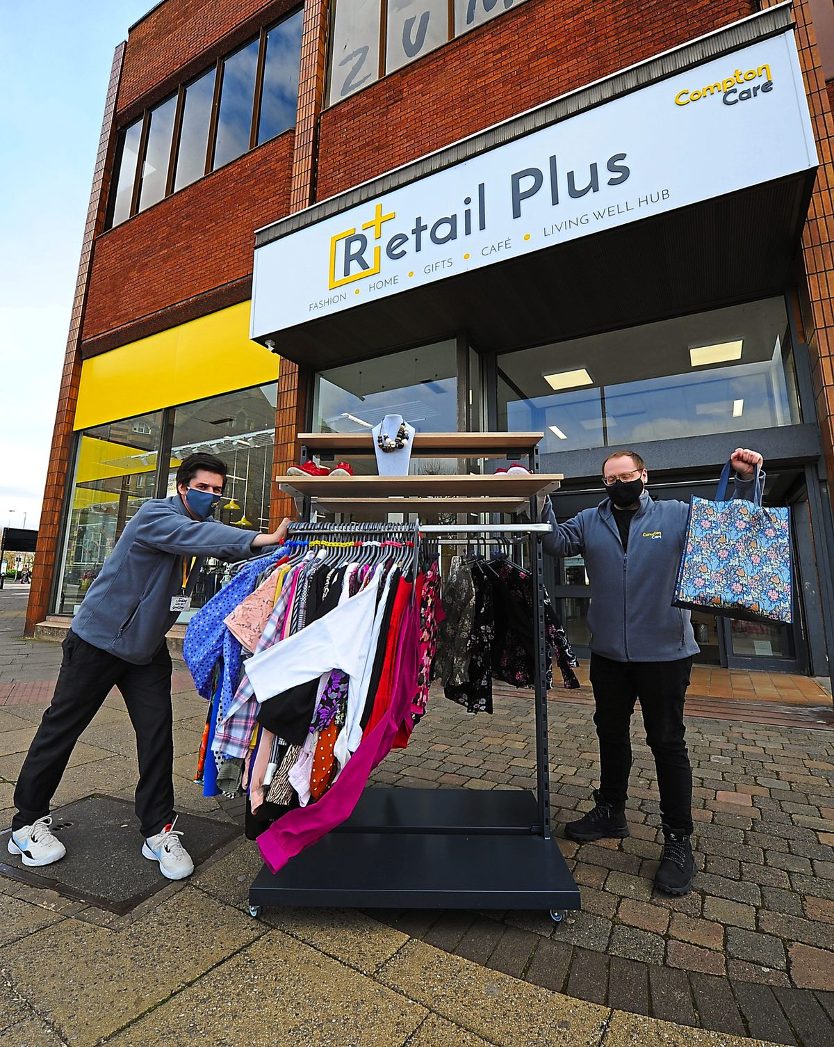 Getting ready to re-open, (left) assistant manager Mike Evans, and (right) area manager Aaron Smith, at Compton Care Retail Plus, Wolverhampton.