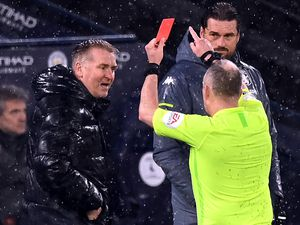 File photo dated 20-01-2021 of Aston Villa manager Dean Smith as he is shown a red card by Referee Jonathan Moss during the Premier League match at the Etihad Stadium, Manchester. Issue date: Friday January 22, 2021. PA Photo. Aston Villa boss Dean Smith will serve a touchline ban against Newcastle after accepting a Football Association charge. See PA story SOCCER Villa. Photo credit should read Shaun Botterill/PA Wire.