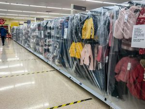 Childrens clothes cordoned off at a supermarket (Ben Birchall/PA)