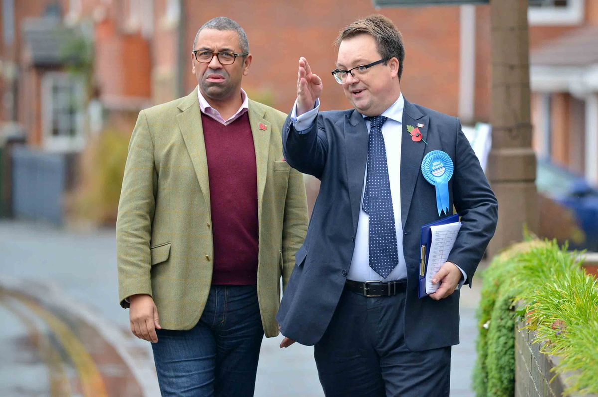 Mike Wood, right, on the campaign trail with party chairman James Cleverley