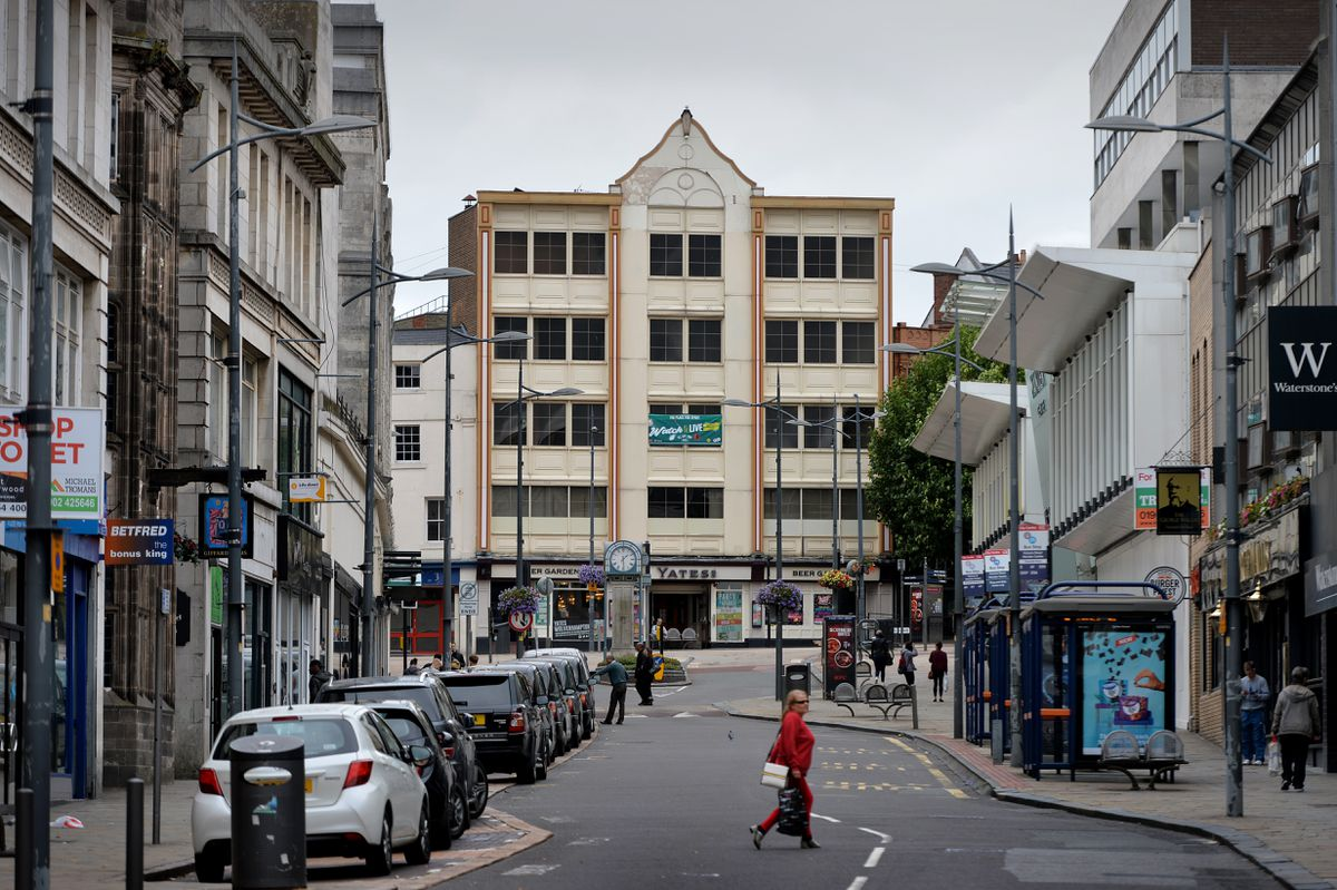 Victoria Street at one of the entrances of the Mander Centre and outside Beatties