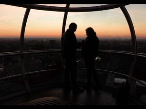 A couple get engaged on the London Eye on Valentine's Day