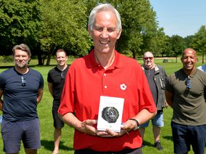 Chris Nicholl was presented the watch by former Walsall players and ISSA in June
