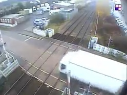 WATCH: Lorry ploughs through level crossing barrier causing train delays
