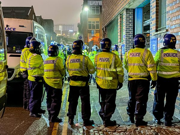 Riot police at a warehouse where an illegal rave took place in Digbeth, Birmingham. Photo: SnapperSK