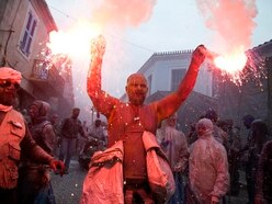In Pictures: Flour power as Greek seaside town marks start of Lent