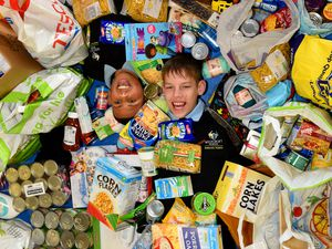 Pupils Zanis Motilkolvs, aged 14, and Jalieal Lilley, 13, from Westcroft School with some of the food collected for the Feed A Family campaign