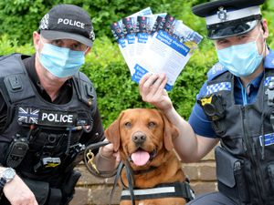 Launch of ShopCop at Stourport Civic Centre, a police initiative to help crackdown on shoplifters and people committing fraud through a messaging system between police and shopkeepers. Pictured left , PC Glen Rees with Waffle and PCSO Andy Stevens from Wyre Forest Safer Neighbourhood Team..