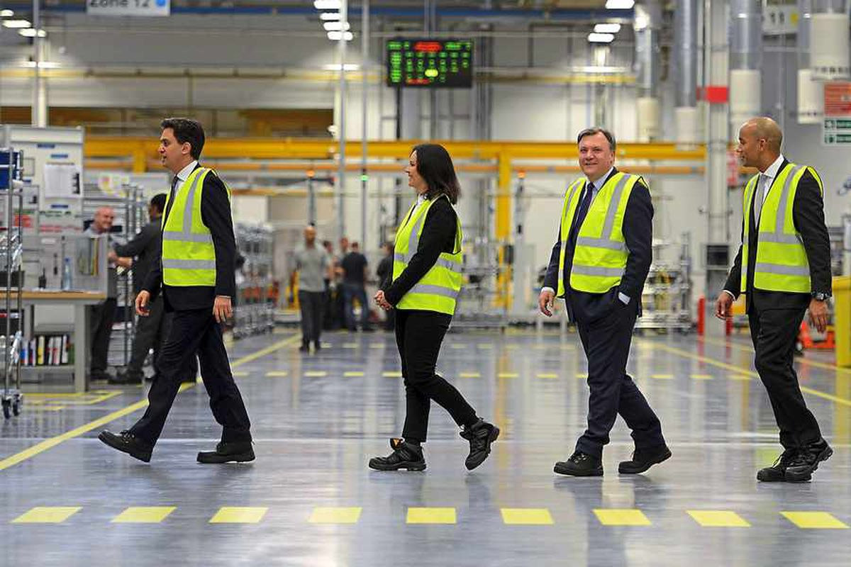 Follow my leader: Ed Miliband with Caroline Flint, Ed Balls and Chuka Umunna at the launch of Labour's economic plan launch at the JLR factory on the I54 site in Wolverhampton