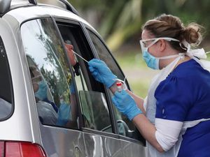 A person is swabbed at a drive-through coronavirus testing site in a car park at Chessington World of Adventures, in southwest London, as the UK continues in lockdown to help curb the spread of the coronavirus. PA Photo. Picture date: Thursday April 2, 2020. See PA story HEALTH Coronavirus. Photo credit should read: Jonathan Brady/PA Wire.
