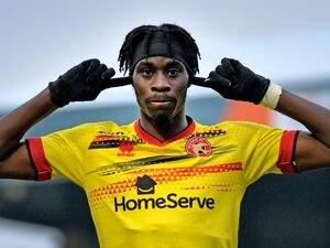 Elijah Adebayo celebrates his first goal