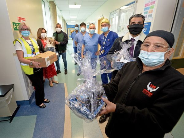 SDB Everyone Prosper presents hampers to the critical care unit at New Cross Hospital
