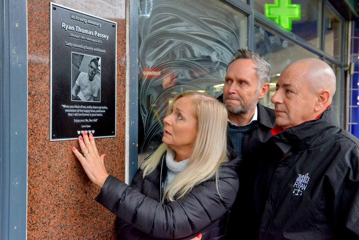 Ryan's family next to the plaque in his memory outside the club where he was stabbed
