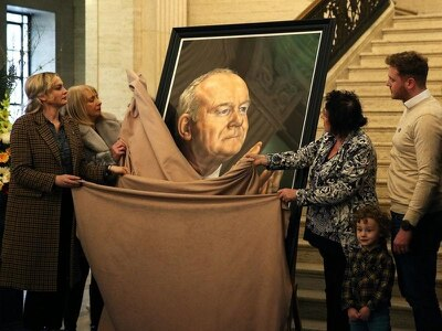 Martin McGuinness portrait unveiled in front of his widow and children