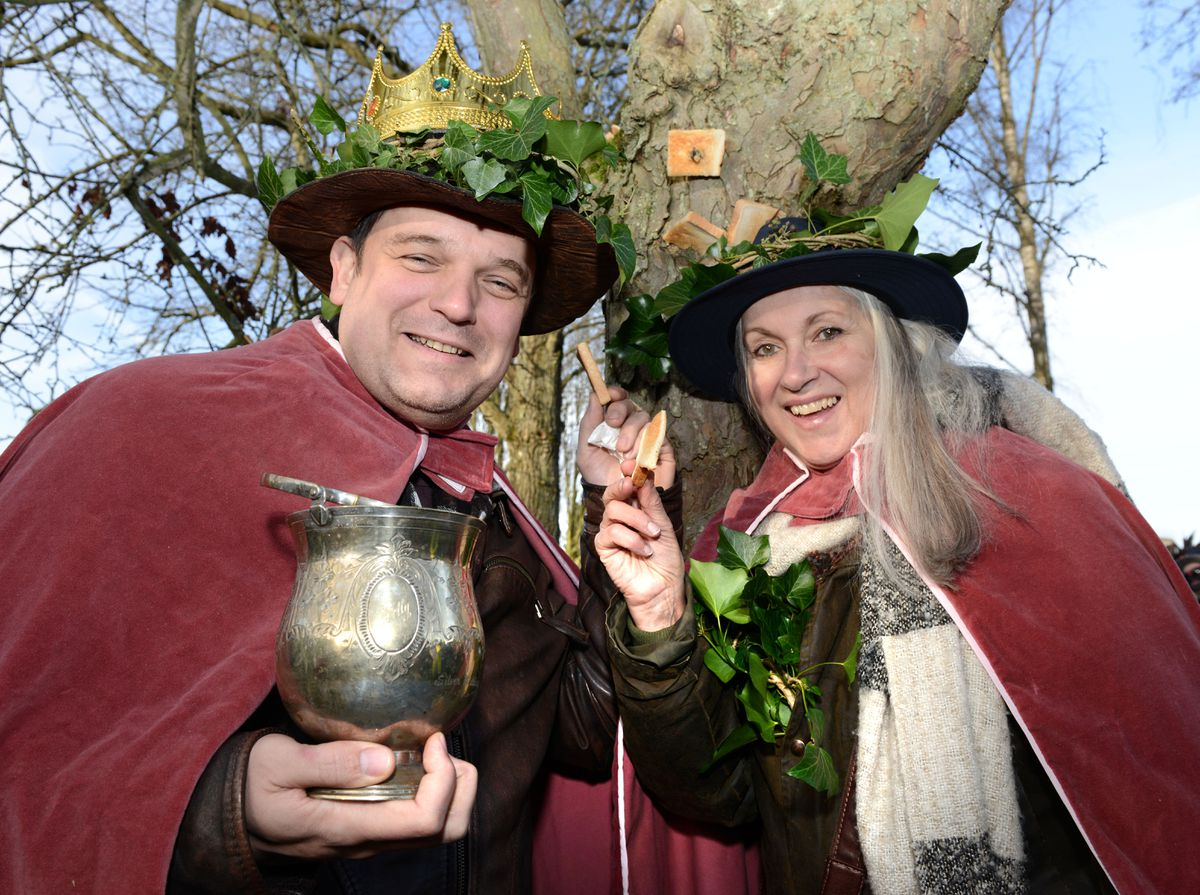 Wassail King and Queen Richard Fields and Jane Duncan scaring away evil spirits at the Winter Wassail at Bodenham Arboretum
