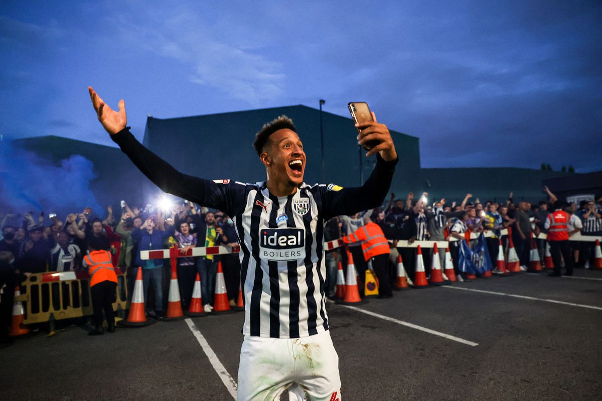 Callum Robinson of West Bromwich Albion celebrates with the fans outside as promotion to the Premier League is confirmed on the final day. (AMA)