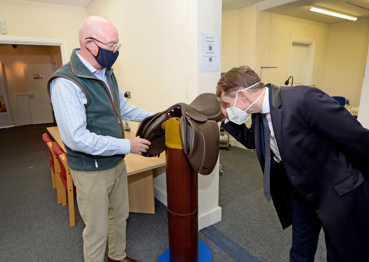 West Midlands Mayor Andy Street takes a closer look at a saddle with Patrick Burns