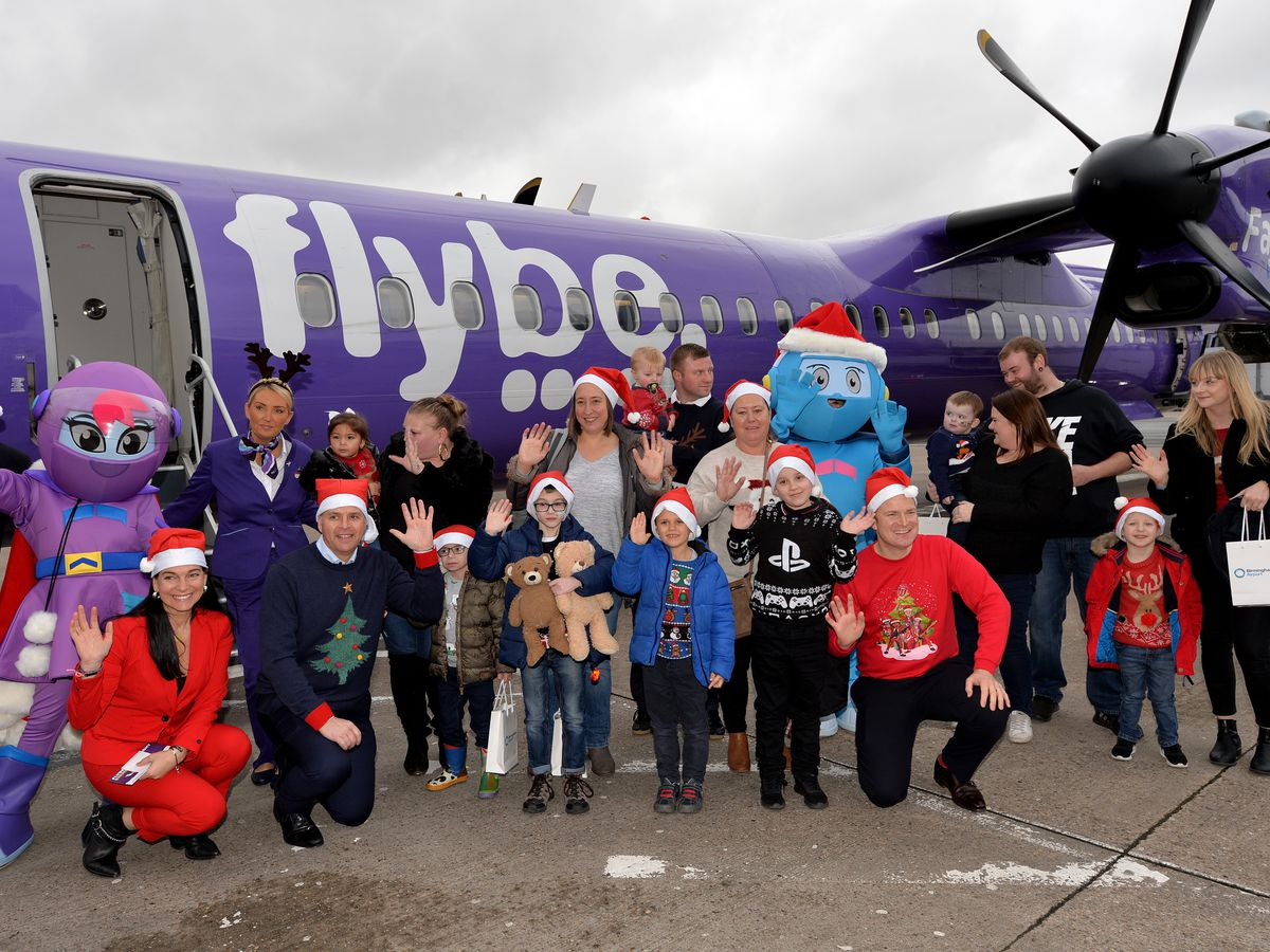 Youngsters and family members from Acorns Hospices ready for take-off at Birmingham Airport