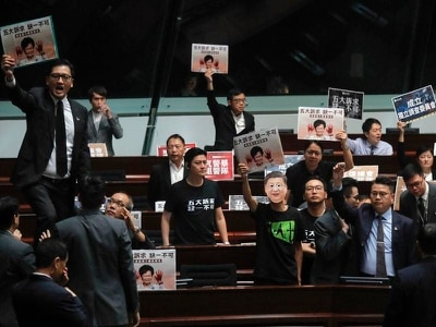 Hong Kong's chief executive forced to halt annual address amid protests