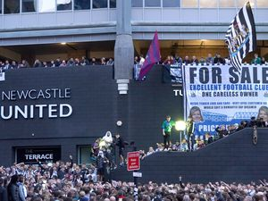 Newcastle United fans celebrating at St James' Park following the announcement that The Saudi-led takeover of Newcastle has been approved.