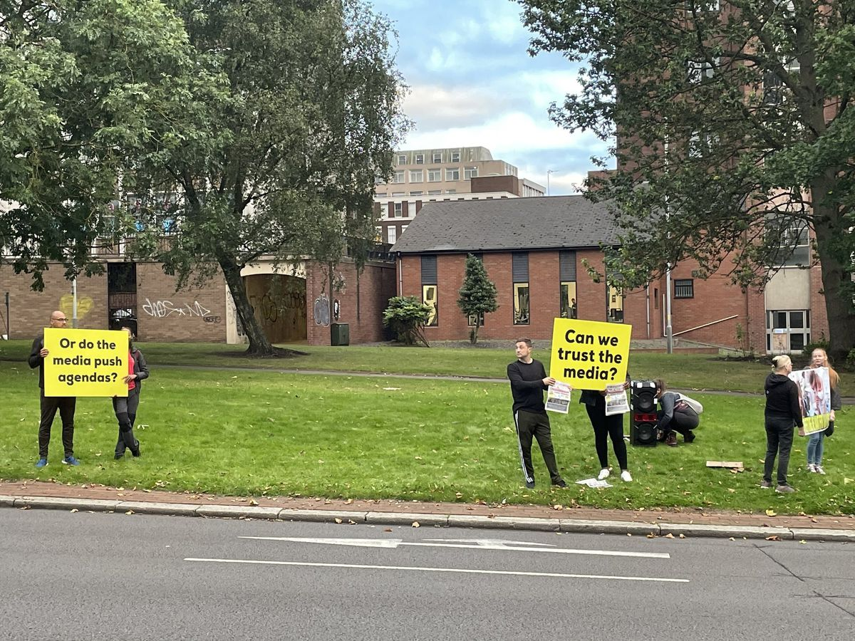 The anti-vaxxers holding signs on the A4150. Photo: Aaron Humphriss