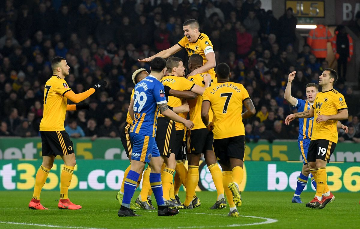 Matt Doherty of Wolverhampton Wanderers scores a goal to make it 1-0 with Conor Coady (AMA)