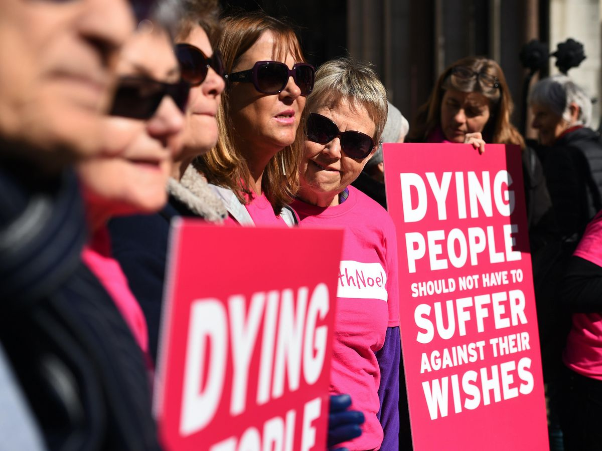 Activists from the Campaign for Dignity in Dying outside the Royal Courts of Justice in London