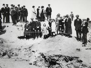 A crowd at a bomb crater in Bradford Place, Walsall.
