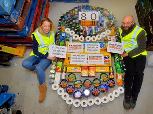 DUDLEY COPYRIGHT EXPRESS AND STAR STEVE LEATH 28/02/2020..Pic in Brierley Hill at the Black Country Food Bank. They have an 80 can Challenge appeal, and pictured with some of the goods that they need is: Jen Coleman and Matthew Newell..