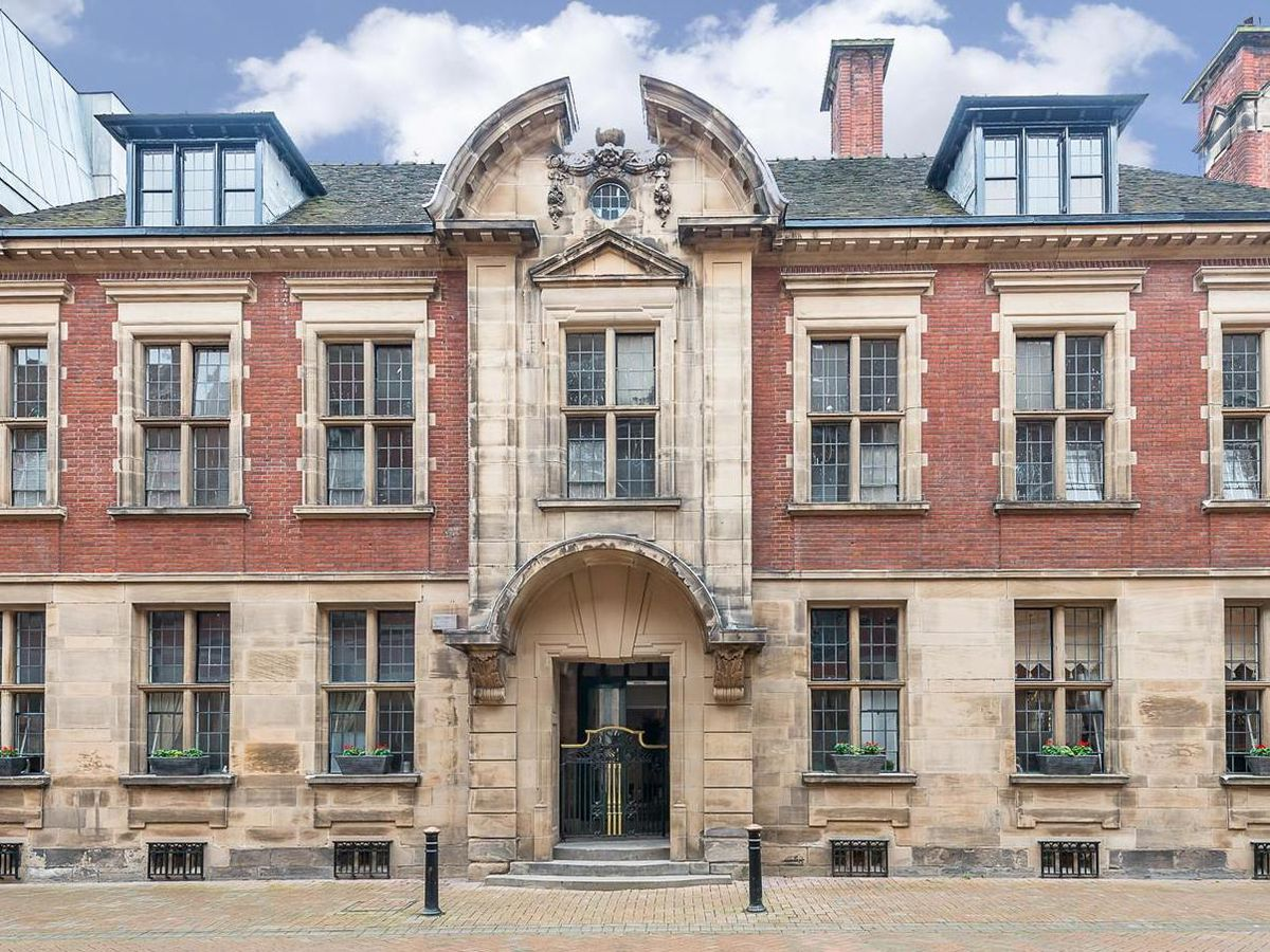 A two-bed flat in this block is up for sale for £295,000 in what used to be a Staffordshire County Council building and register office