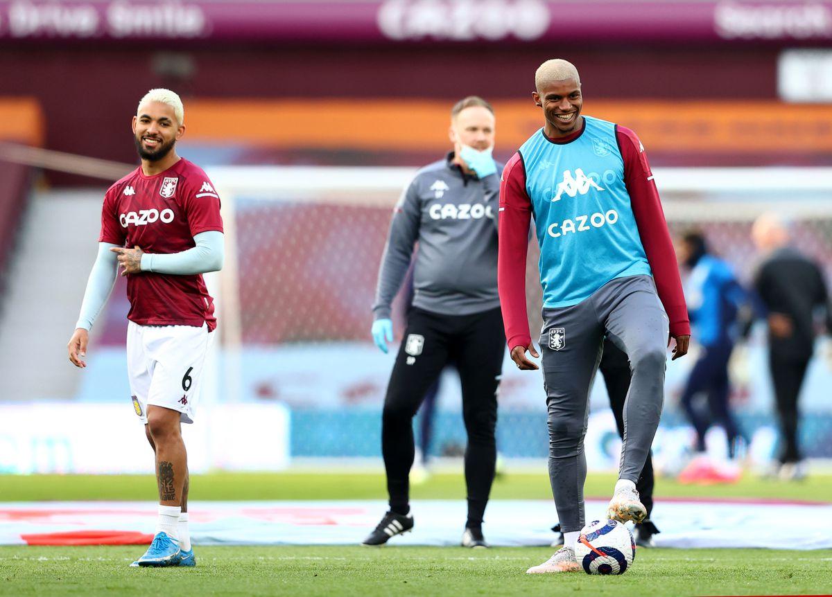 Aston Villa's Wesley (right) warming up