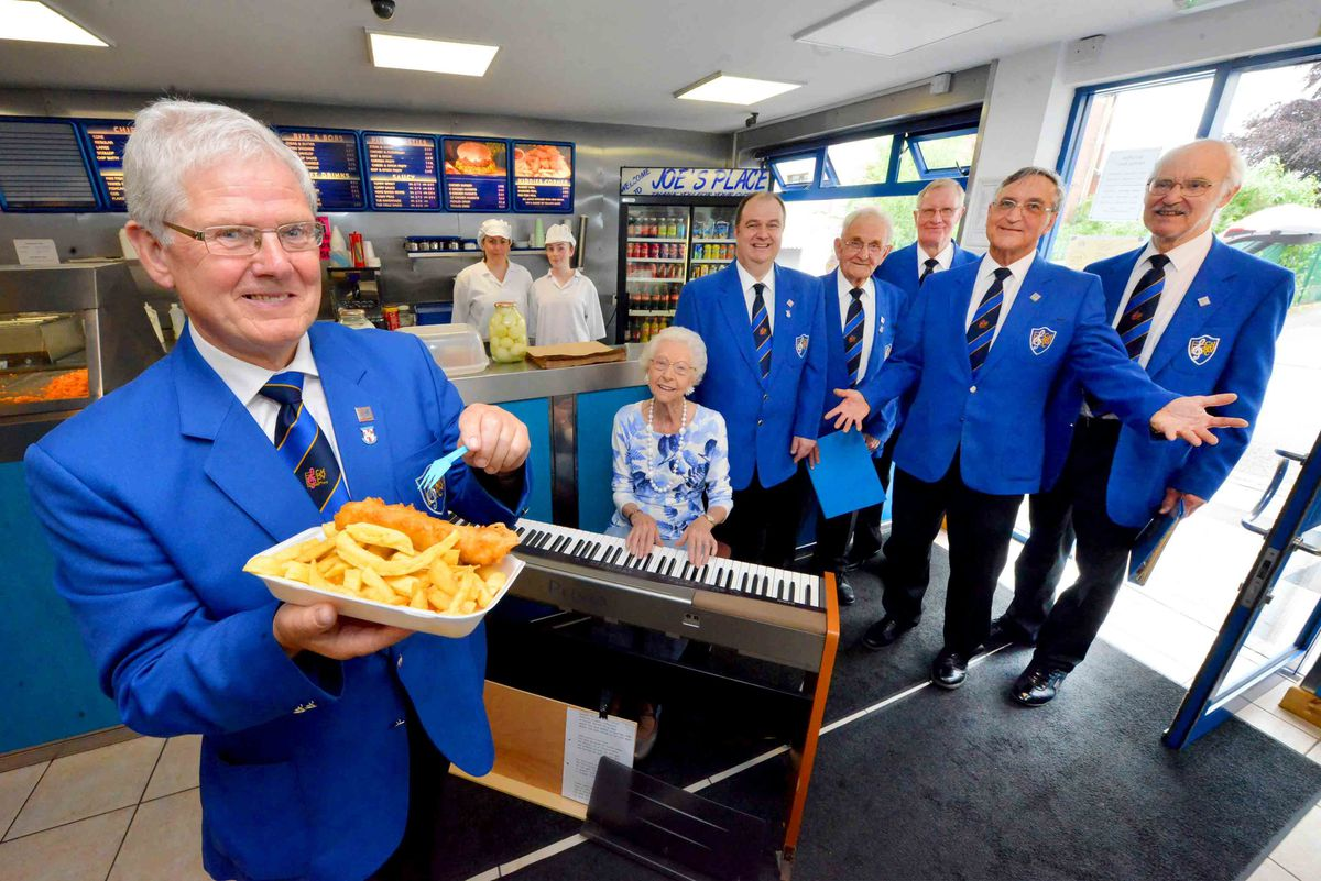 Cradley Heath Male Voice Choir, singing in Joe's Chip Shop, were Cynthia Partridge on the keyboard and left to right, Eddie Nicholls, David Perry, John Pritchard, Roy Gadd, Andrew Lacon, Peter Freakley, watched on by staff Kyra Cutler-Harvoutt and Jessica Marsden