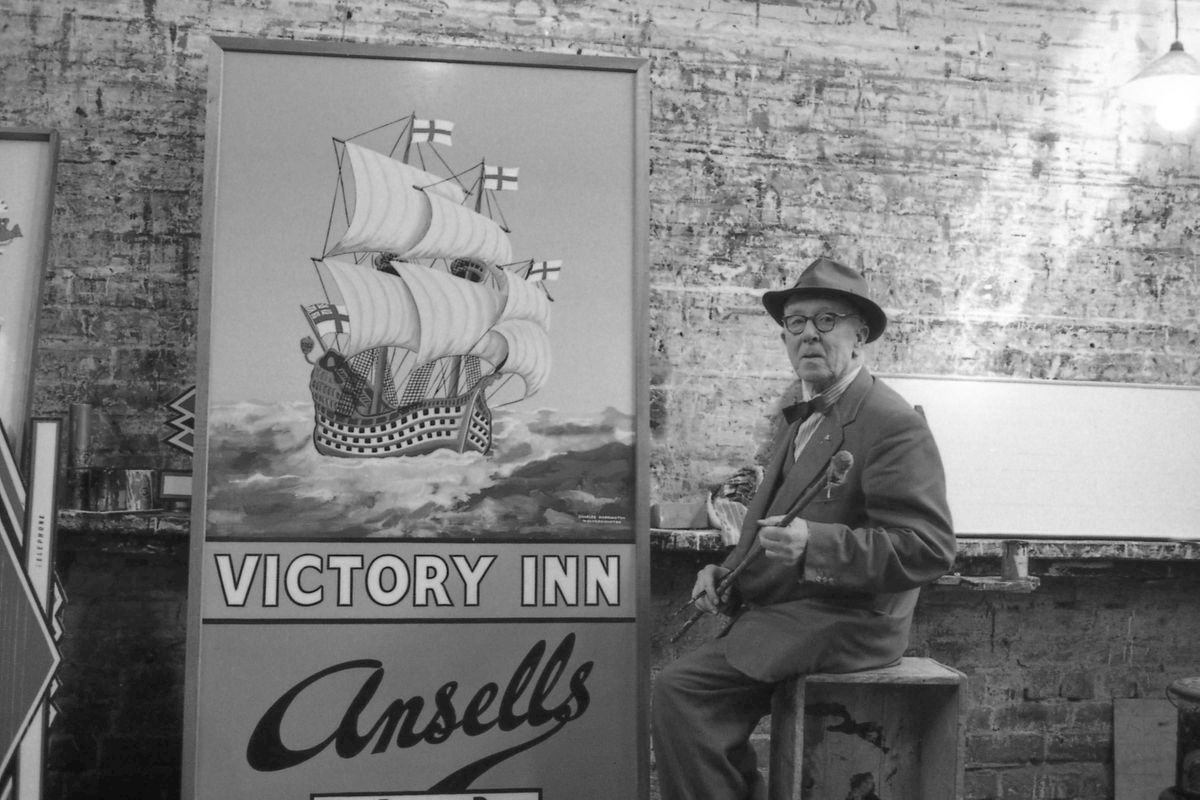 Andy's grandfather with one of his works, for The Victory Inn. Location unknown.