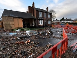 Schools closed and home wrecked as burst main floods Tipton road again