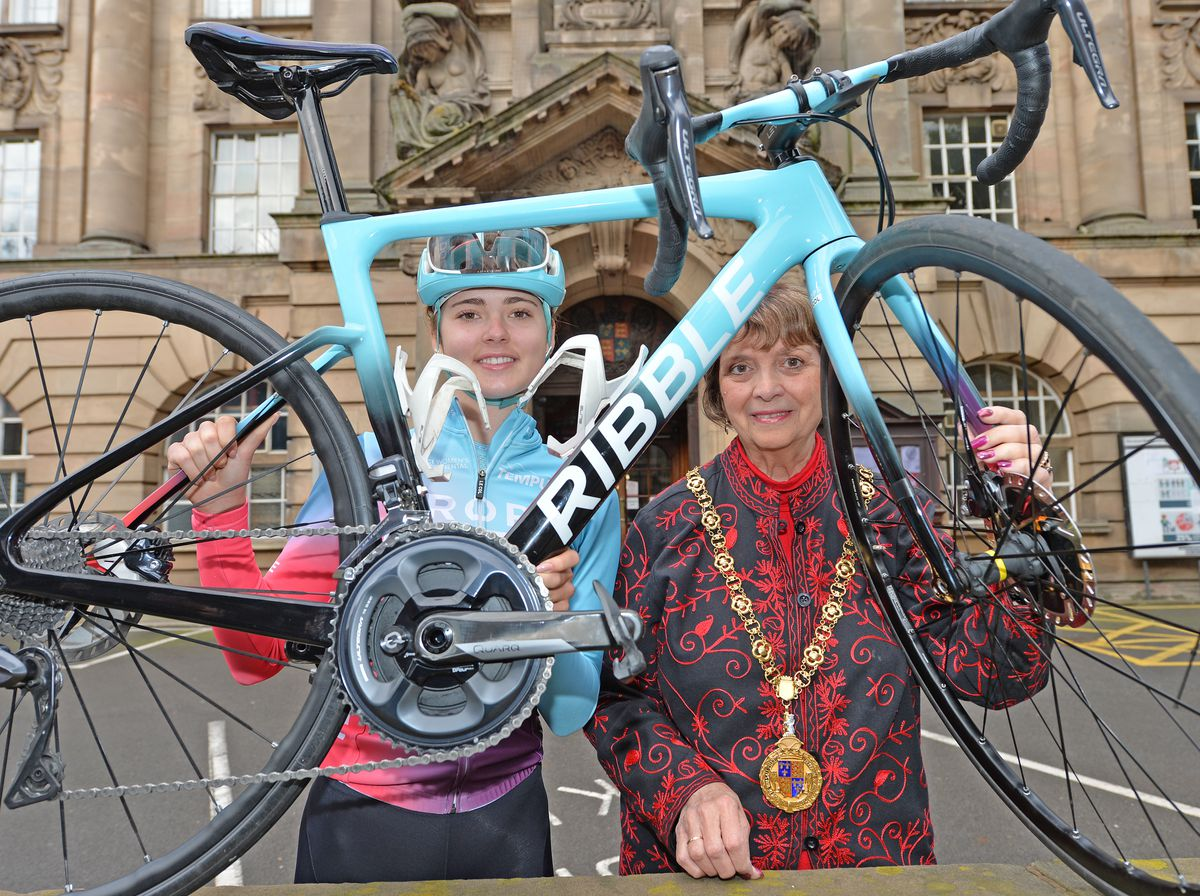 Alice Towers shows Mayor of Walsall Councillor Rose Burley the bike she will be taking to the roads around the town on