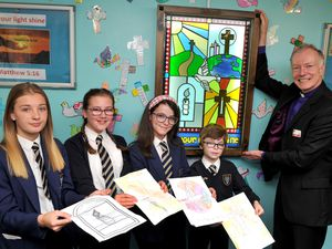 Bishop Clive who has unveiled a stained glass window which has been designed by pupils at Bilbrook C of E Middle School. With their designs which have made up the window Louise Brain 13, Emma Long 11, Kadi Tattersall 12 and Lance Howell 10