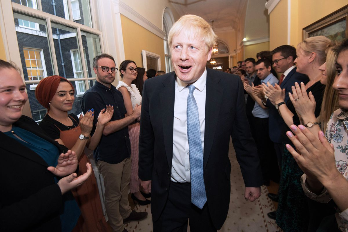 Prime Minister Boris Johnson is clapped into 10 Downing Street by staff following the 2019 General Election