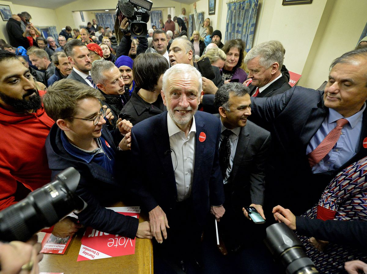 Labour leader Jeremy Corbyn surrounded by supporters at the Upper Gornal Pensioners Club in Dudley