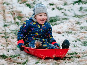 Three-year-old Jack Bates is excited to try out his sledge