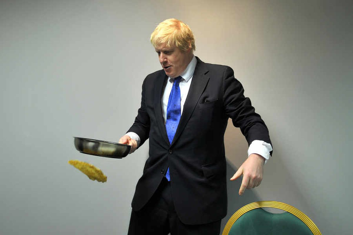 Boris Johnson attempts pancake flipping in a visit to ThePremier Suite in Cannock
