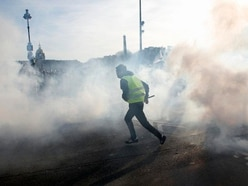 Tear gas and hate speech marks 14th straight yellow vest protest
