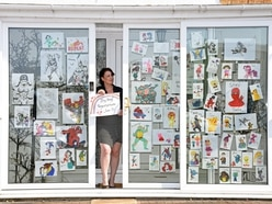 I need a hero: Hand-drawn window display spreads cheer in Stourport