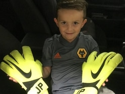 England goalkeeper Jordan Pickford's gloves in safe hands with young Wolves fan