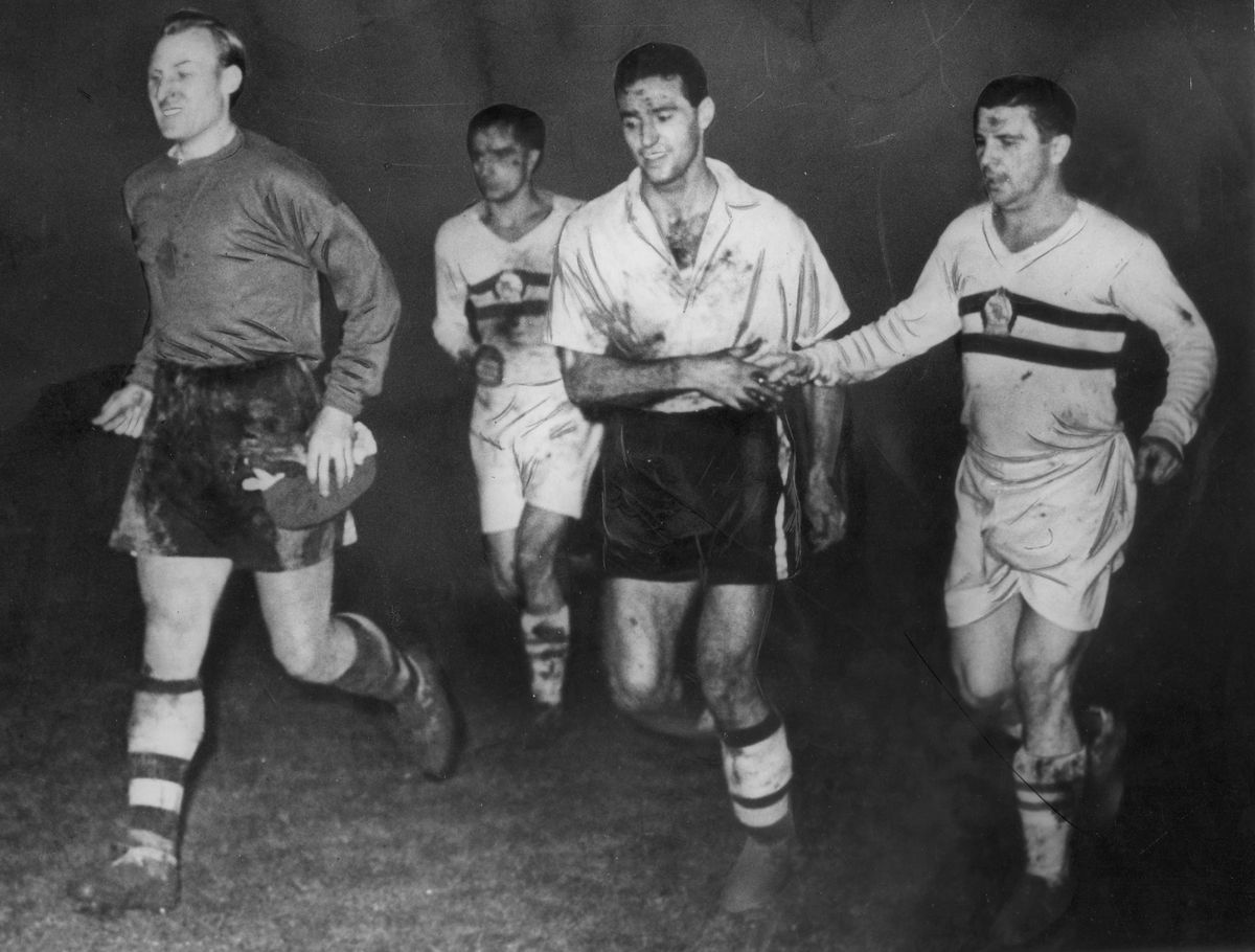 Bert Williams (left), Eddie Stuart (centre) and the legendary Ferenc Puskas (right) leave the field after Wolves beat Honved 3-2