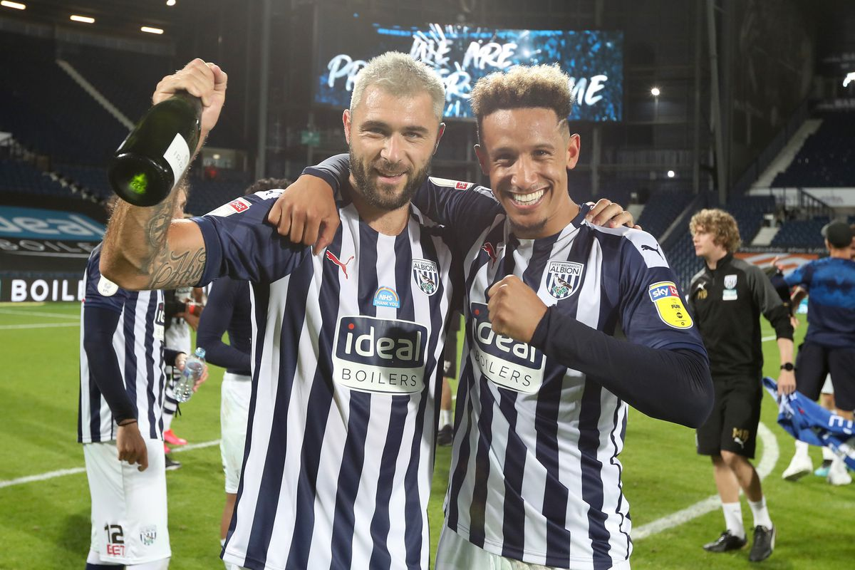 Charlie Austin of West Bromwich Albion and Callum Robinson of West Bromwich Albion  celebrate promotion to the Premier League on the pitch at the end of the match. (AMA)