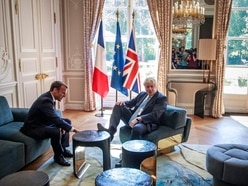 Boris Johnson puts foot on table during Brexit talks with Emmanuel Macron